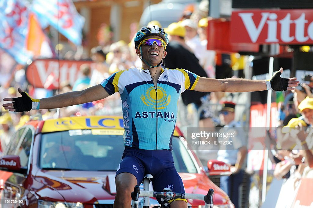 Tour de France winner and Kazakh cycling team Astana (AST)'s leader Alberto Contador of Spain jubilates on the finish line after winning on July 19, 2009 the 207,5 km and fifteenth stage of the 2009 Tour de France cycling race run between Pontarlier and Verbier (Switzerland).