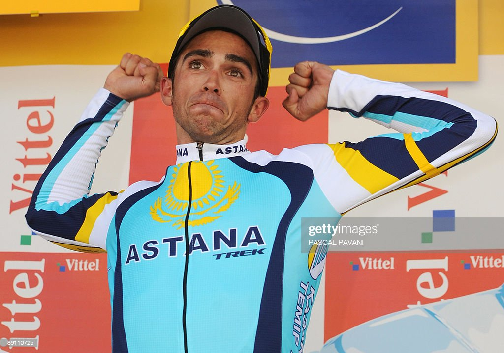 Tour de France winner and Kazakh cycling team Astana (AST)'s leader Alberto Contador of Spain jubilates on the podium after winning and taking the yellow jersey of overall leader on July 19, 2009 at the end of the 207,5 km and fifteenth stage of the 2009 Tour de France cycling race run between Pontarlier and Verbier (Switzerland). Contador won ahead of Danish cycling team Team Saxo Bank (SAX)'s leader Andy Schleck of Luxemburg and Italian cycling team Liquigas (LIQ)'s Vincenzo Nibali of Italy.