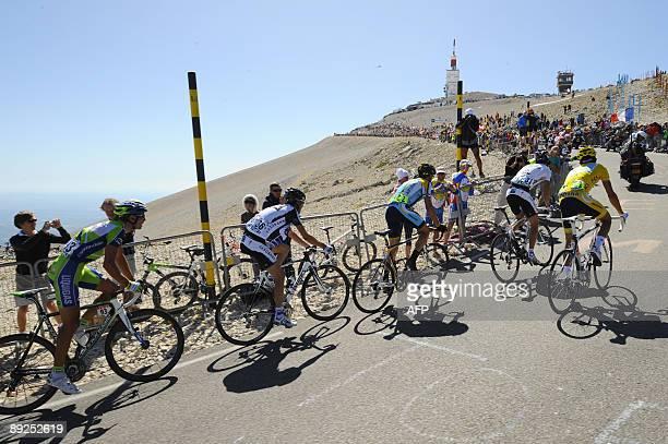 2007 Tour de France winner and Kazakh cycling team Astana 's leader Alberto Contador of Spain rides with Danish cycling team Team Saxo Bank 's leader...