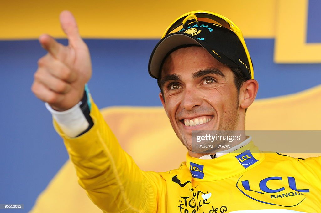 Tour de France winner and Kazakh cycling team Astana (AST)'s leader Alberto Contador of Spain jubilates his yellow jersey of overall leader after winning on July 19, 2009 the 207,5 km and fifteenth stage of the 2009 Tour de France cycling race run between Pontarlier and Verbier (Switzerland). Contador won ahead of Danish cycling team Team Saxo Bank (SAX)'s leader Andy Schleck of Luxemburg and Italian cycling team Liquigas (LIQ)'s Vincenzo Nibali of Italy.