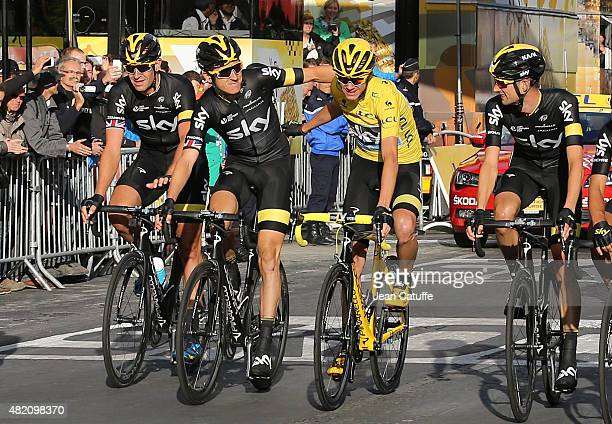 Tour de France winner Chris Froome of Great Britain and Team Sky is surrounded by his teammates Ian Stannard of Great Britain Geraint Thomas of Great...