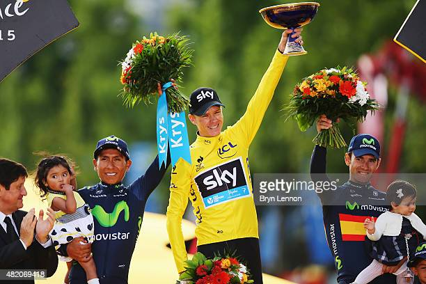 Tour de France winner Chris Froome of Great Britain and Team Sky celebrates alongside second placed Nairo Quintana of Colombia and Movistar Team and...