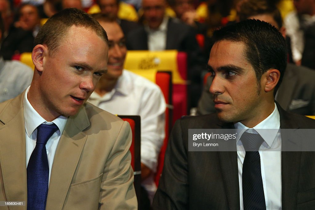 Tour de France winner <a gi-track='captionPersonalityLinkClicked' href=/galleries/search?phrase=Chris+Froome&family=editorial&specificpeople=5428054 ng-click='$event.stopPropagation()'>Chris Froome</a> (l) of Great Britain chats to <a gi-track='captionPersonalityLinkClicked' href=/galleries/search?phrase=Alberto+Contador&family=editorial&specificpeople=562697 ng-click='$event.stopPropagation()'>Alberto Contador</a> of Spain prior to the route presentation of 2014 Tour de France at the Palais des Congres de Paris on October 23, 2013 in Paris, France. The 101st edition of the Tour de France will start with 3 stages in England.