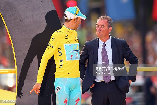 Tour de France winner Vincenzo Nibali of Italy and The Astana Pro Team chats to 5 times Tour de France winner Bernard Hinault after the twenty first...