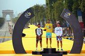 Tour de France winner Vincenzo Nibali of Italy and The Astana Pro Team stands on the podium with JeanChristophe Peraud of France and AG2R la Mondiale...