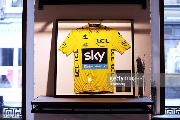 A Tour de France yellow jersey signed by race winner Chris Froome hangs on display in the cafe area at the Rapha Racing Ltd cycle club on Brewer...