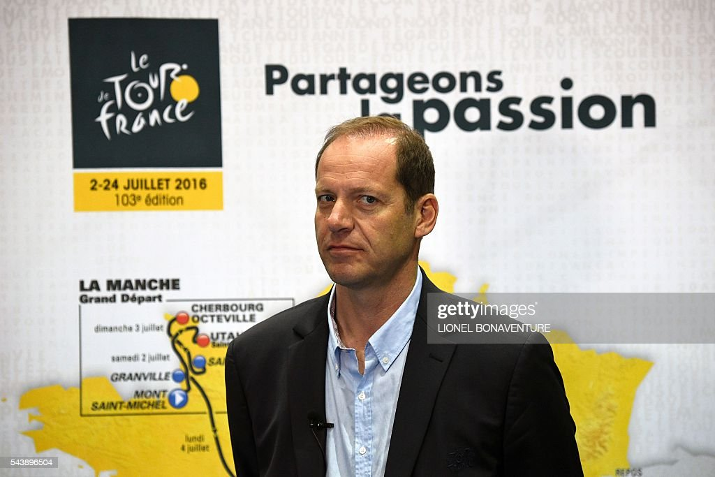 Tour de France's director Christian Prudhomme poses at the press center in Saint-Lo, on July 30, 2016, two days before the start of the 103rd edition of the Tour de France cycling race. The 2016 Tour de France will start on July 2 in the streets of Le Mont-Saint-Michel and ends on July 24, 2016 down the Champs-Elysees in Paris. / AFP / LIONEL