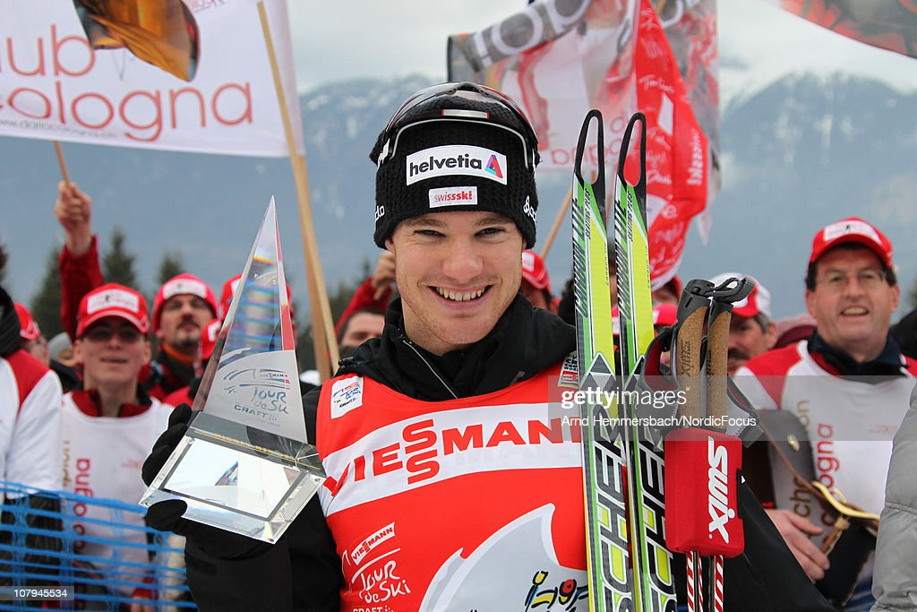Tour de Ski overall winner <a gi-track='captionPersonalityLinkClicked' href=/galleries/search?phrase=Dario+Cologna&family=editorial&specificpeople=4779620 ng-click='$event.stopPropagation()'>Dario Cologna</a> of Switzerland celebrates after the final climb men for the FIS Cross Country World Cup Tour de Ski on January 9, 2011 in Val di Fiemme, Italy.
