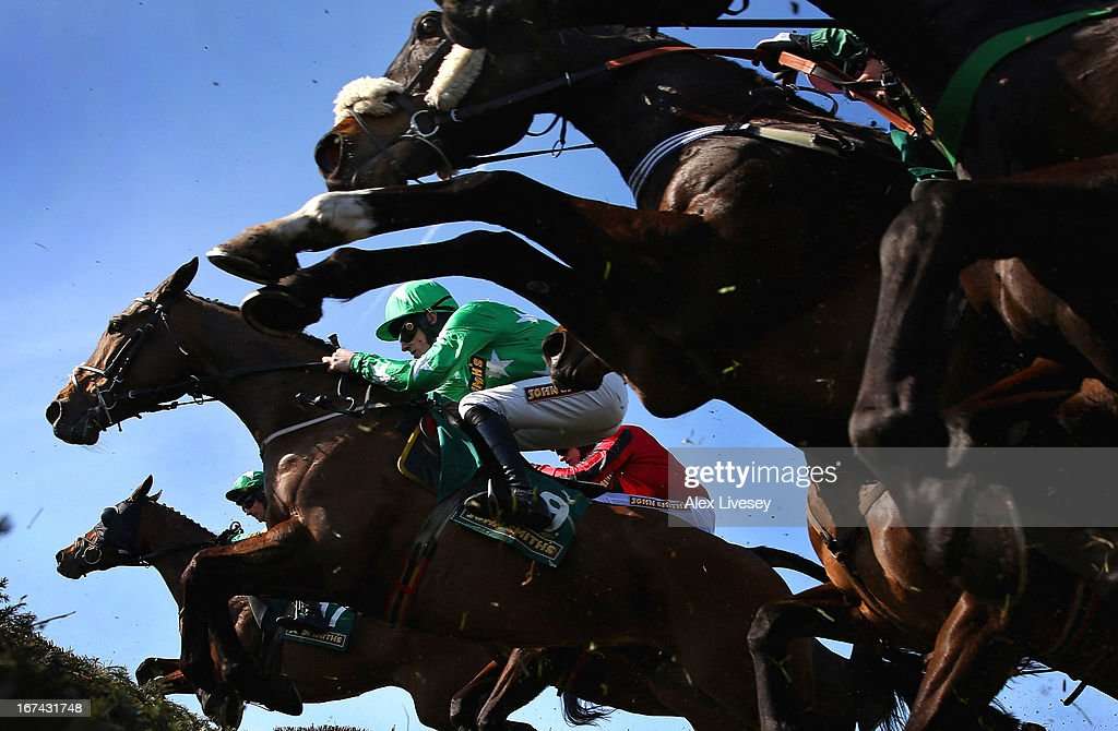 Tour Des Champs ridden by Sam Twiston-Davies jumps a fence during The John Smith's Handicap Steeple Chase at Aintree Racecourse on April 6, 2013 in Liverpool, England.