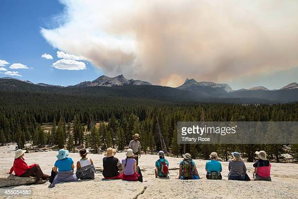 A tour group listens to a park ranger while the Meadow wildfire burns on September 7 2014 in in Yosemite National Park California Almost 2600 acres...