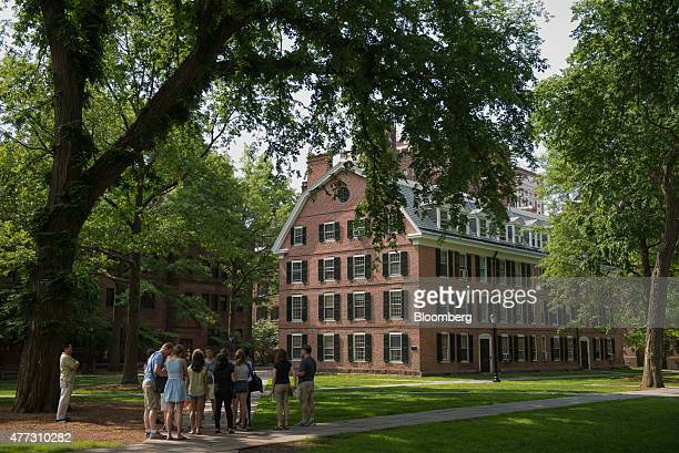 A tour group makes a stop at Connecticut Hall on the Yale University campus in New Haven Connecticut US on Friday June 12 2015 Yale University is an...