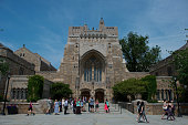 A tour group makes a stop at the Sterling Memorial Library on the Yale University campus in New Haven Connecticut US on Friday June 12 2015 Yale...
