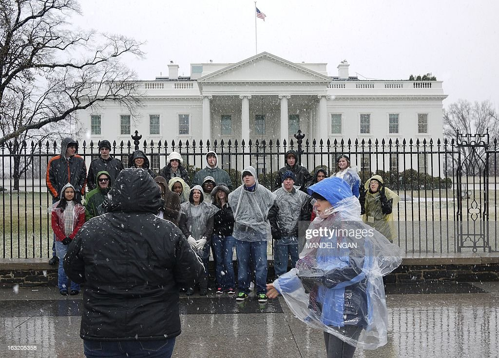 A tour group poses for a photo in front of the White House as snow falls on March 6, 2013 in Washington, DC. A winter storm warning remains in effect until early Thursday. A massive winter storm pounding the northern United States Tuesday grounded 2,600 flights, closed hundreds of schools and made roadways and highways impassible. At least four people were reportedly killed in accidents on icy and snow covered roads and highways. More than a dozen states from Minnesota to Virginia were in the path of the huge storm, which had already dumped as much as two feet (60 centimeters) of snow in Montana and 15 inches (38 centimeters) in North Dakota. Mandel NGAN