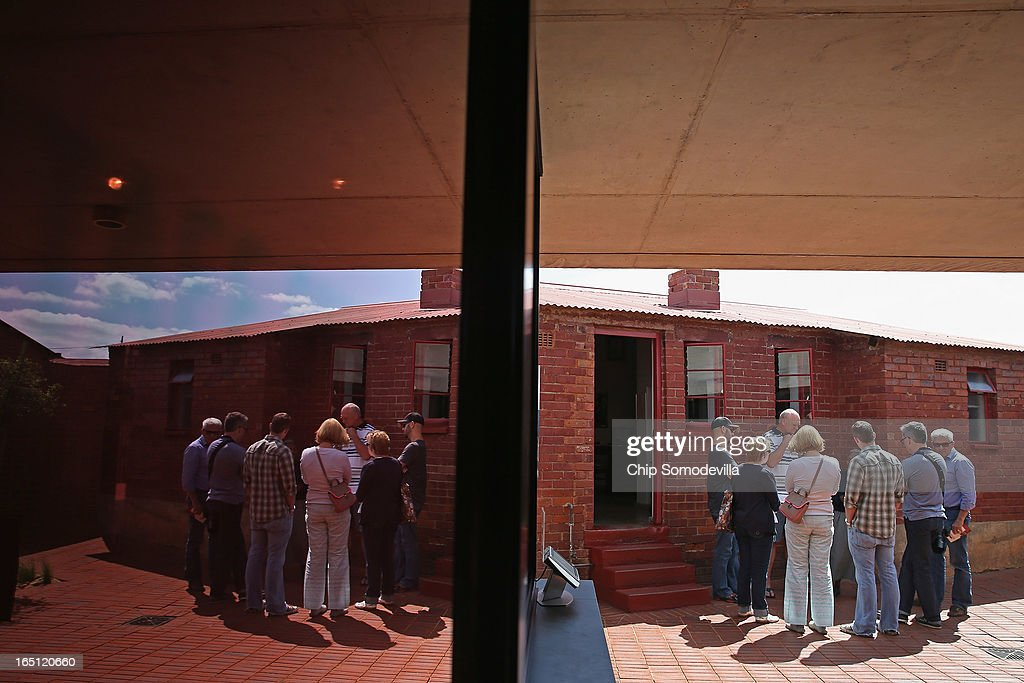 A tour group prepares to endter the Mandela House and Museum on historic Vilakazi Street in Soweto March 31, 2013 in Johannesburg, South Africa. From 1946 to 1990 this was the home of former South African President Nelson Mandela, 94, who is in the hospital for the third time since December with lung problems. Referring to Mandela by clan name, Madiba, President Jacob Zuma said, 'We appeal to the people of South Africa and the world to pray for our beloved Madiba and his family and to keep them in their thoughts.' Mandela's lungs were damaged when he contracted tuberculosis during his 27 years in the infamous Robben Island prison. Mandela became the nation's first democratically elected president in 1994 following the end of apartheid.
