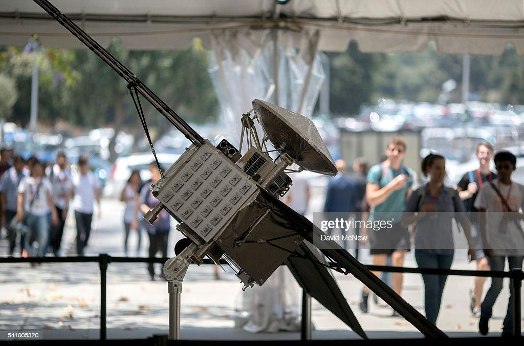A tour group views a 1/4 scale model of the Juno spacecraft as NASA officials and the public look forward to the Independence Day arrival of the the Juno spacecraft to Jupiter, at JPL on June 30, 2016 in Pasadena, California. After having traveling nearly 1.8 billion miles over the past five years, the NASA Juno spacecraft will arrival to Jupiter on the Fourth of July to go enter orbit and gather data to study the enigmas beneath the cloud tops of Jupiter. The risky $1.1 billion mission will fail if it does not enter orbit on the first try and overshoots the planet.