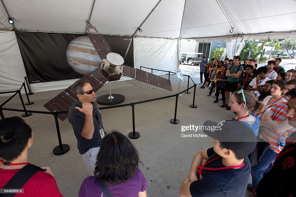 A tour group views a one-quarter-scale model of the Juno spacecraft as NASA officials and the public look forward to the Independence Day arrival of the the Juno spacecraft to Jupiter, at JPL on June 30, 2016 in Pasadena, California. After having traveling nearly 1.8 billion miles over the past five years, the NASA Juno spacecraft will arrival to Jupiter on the Fourth of July to go enter orbit and gather data to study the enigmas beneath the cloud tops of Jupiter. The risky $1.1 billion mission will fail if it does not enter orbit on the first try and overshoots the planet.