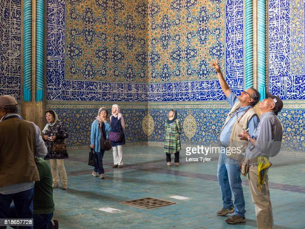 A tour guide explains the architecture inside Lotfollah Mosque the first mosque to be built on Esfahan's iconic Naqshe Jahan Square Iran Shah Abbas...