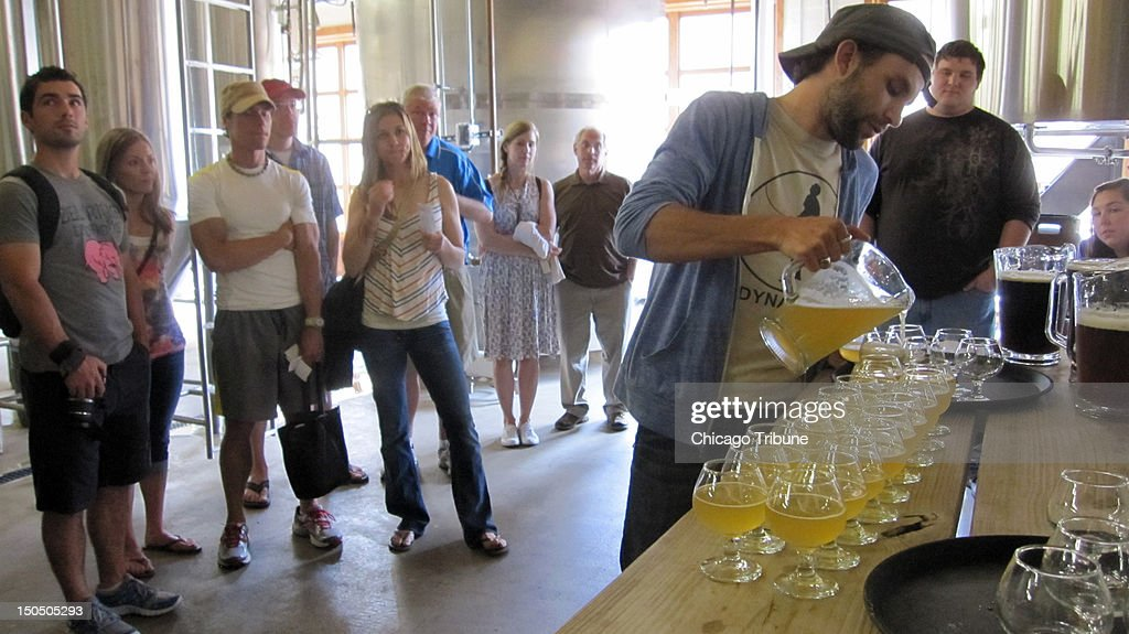 A tour guide fills glasses during the brewery tour at Brewery Vivant in Grand Rapids Michigan The city Michigan's secondlargest was the winner of an...