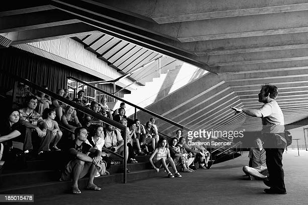 A tour guide presents to tourists at the Sydney Opera House on September 26 2013 in Sydney Australia On October 20 2013 the iconic Sydney Opera House...