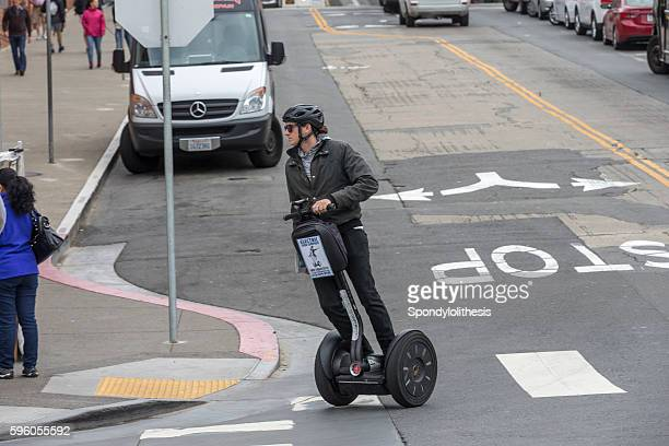 Tour guide running segway at San Francisco Downtown