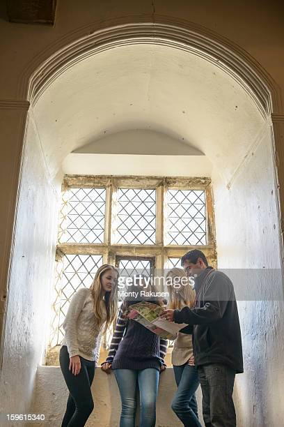 Tour guide showing visitors points of interest at Bolton Castle, a 14th century Grade 1 listed building, Scheduled Ancient Monument