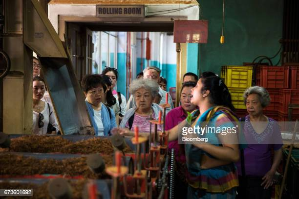 A tour guide speaks to a group of tourists visiting the factory of the Geragama Tea Estate operated by Pussellawa Plantations Ltd in Pilimathalawa...