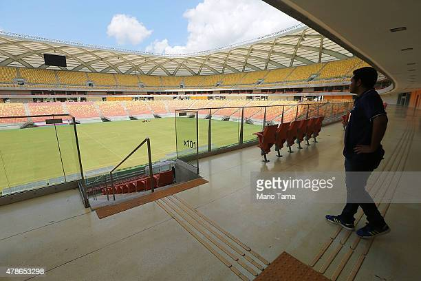 A tour guide stands in the Arena de Amazonia June 26 2015 in Manaus Brazil The arena was constructed for $300 million as one of the host sites for...