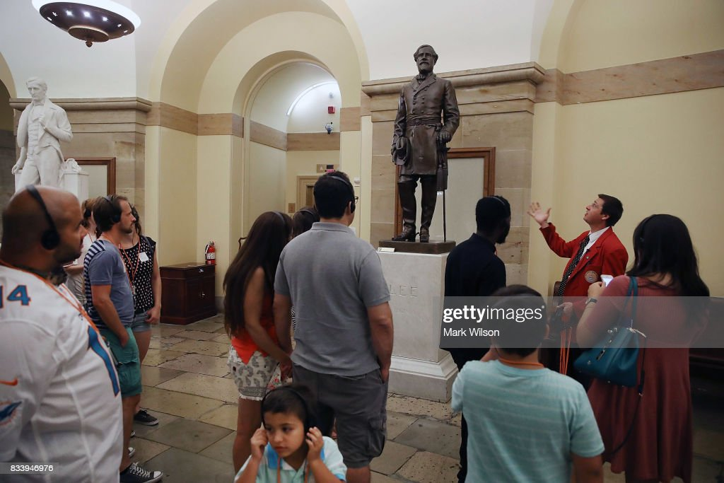 A tour guide talks about the Statue of Confederate General Robert E. Lee that is located inside the US Capitol August 17, 2017 in Washington, DC. House Minority Leader Nancy Pelosi (D-CA) has called for the removal of all Confederate statues from the United States Capitol.
