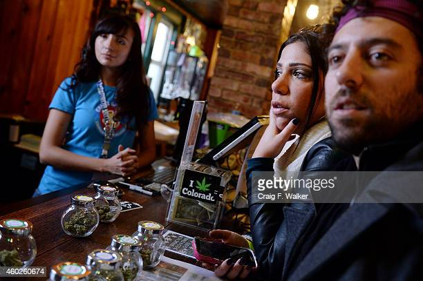 Tour members that asked not to be identified explore the merchandise at La Conte's Clone Bar Dispensary during a marijuana tour hosted by My 420...