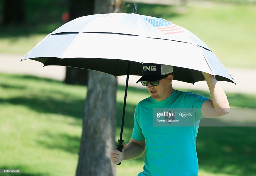 Tour player Martin Piller watches the play of his wife Gerina during the final round of the Volunteers of America Texas Shootout at Las Colinas Country Club on May 1, 2016 in Irving, Texas.