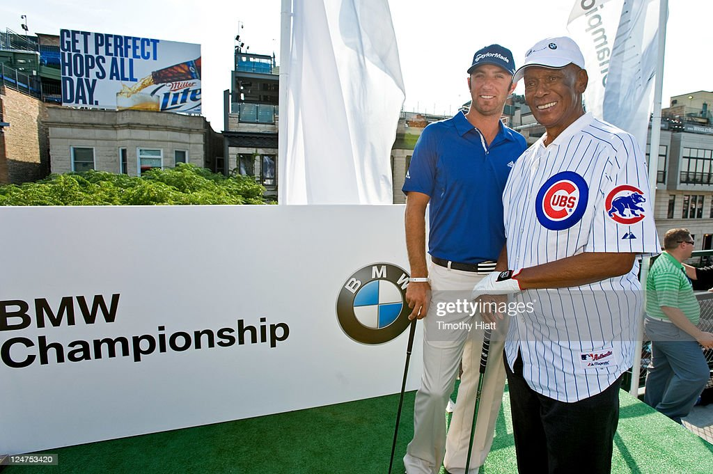 Tour Pro <a gi-track='captionPersonalityLinkClicked' href=/galleries/search?phrase=Dustin+Johnson&family=editorial&specificpeople=3908453 ng-click='$event.stopPropagation()'>Dustin Johnson</a> and Baseball Hall-Of-Famer <a gi-track='captionPersonalityLinkClicked' href=/galleries/search?phrase=Ernie+Banks&family=editorial&specificpeople=167021 ng-click='$event.stopPropagation()'>Ernie Banks</a> Hit Golf Balls From The Stands At Wrigley Field To Kick-Off The 2011 BMW Championship at Wrigley Field on September 12, 2011 in Chicago, Illinois.
