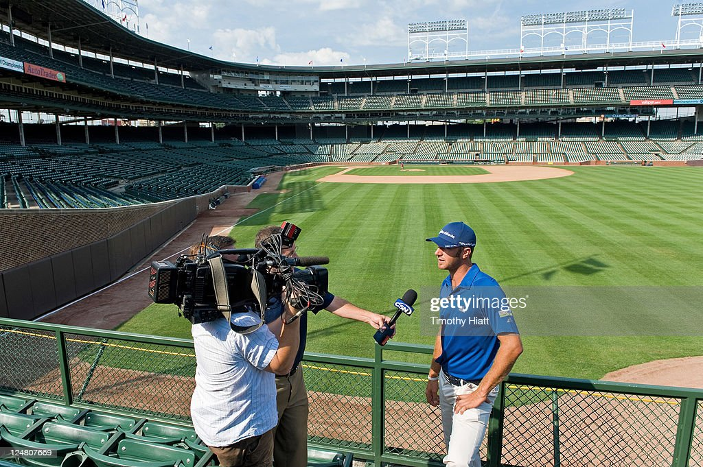 Tour Pro <a gi-track='captionPersonalityLinkClicked' href=/galleries/search?phrase=Dustin+Johnson&family=editorial&specificpeople=3908453 ng-click='$event.stopPropagation()'>Dustin Johnson</a> Hits Golf Balls From The Stands At Wrigley Field To Kick-Off The 2011 BMW Championship at Wrigley Field on September 12, 2011 in Chicago, Illinois.