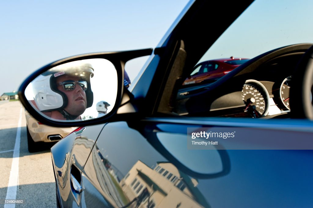 Tour Professional Mark Leishman takes a BMW for a test drive to raise money to benefit the Evans Scholars Foundation at Autobahn Racetrack on September 13, 2011 in Joliet, Illinois.