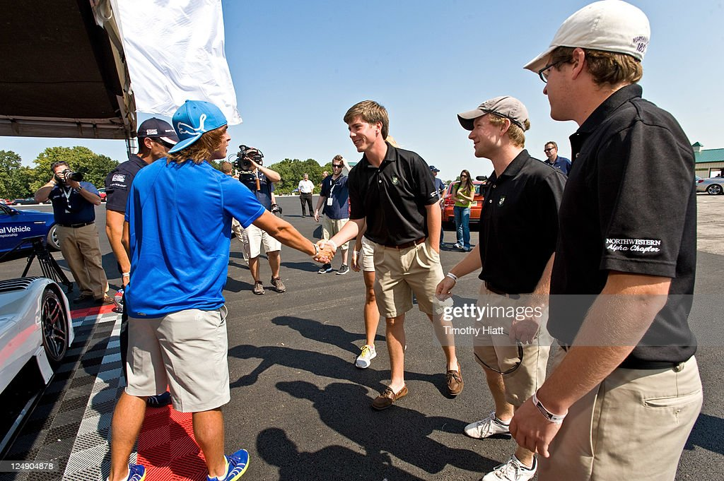 Tour Professional <a gi-track='captionPersonalityLinkClicked' href=/galleries/search?phrase=Rickie+Fowler&family=editorial&specificpeople=4466576 ng-click='$event.stopPropagation()'>Rickie Fowler</a> and BMW American LeMans Series race driver Joey Hand at Autobahn Racetrack to raise money to benefit the Evans Scholars Foundation on September 13, 2011 in Joliet, Illinois.