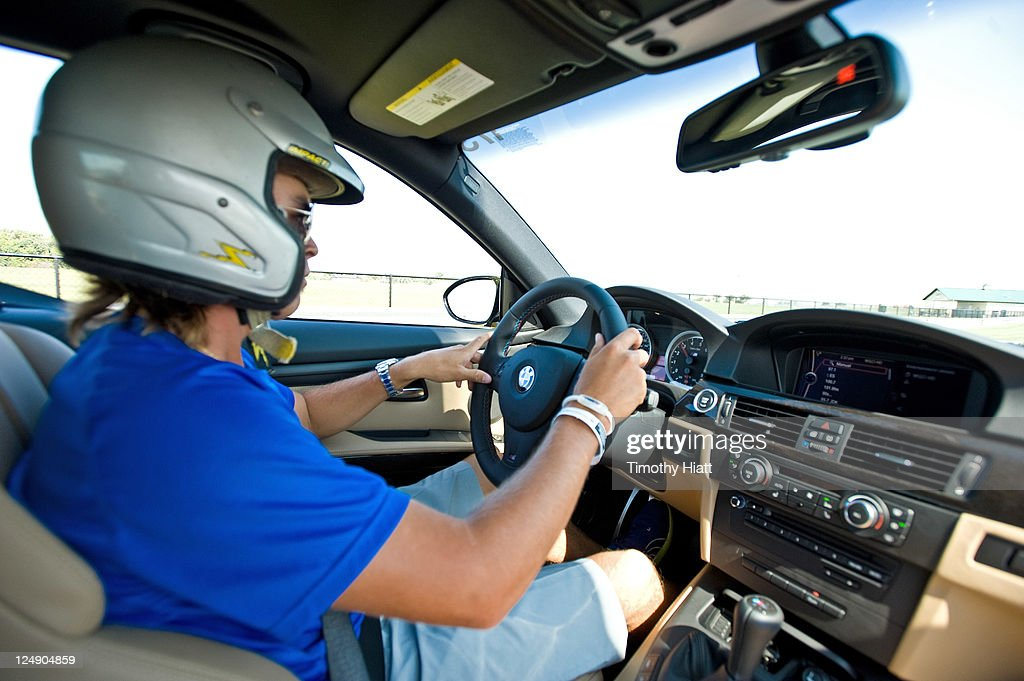Tour professional <a gi-track='captionPersonalityLinkClicked' href=/galleries/search?phrase=Rickie+Fowler&family=editorial&specificpeople=4466576 ng-click='$event.stopPropagation()'>Rickie Fowler</a> test drives BMWs to raise money to benefit the Evans Scholars Foundation at Autobahn Racetrack on September 13, 2011 in Joliet, Illinois.