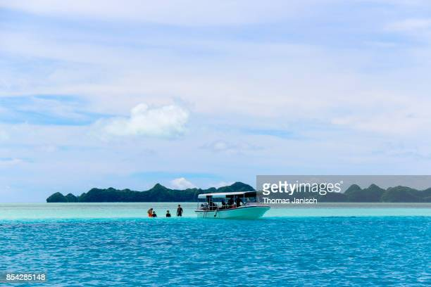 Tourboat stopping at a sand bank within the Rock Islands, Palau