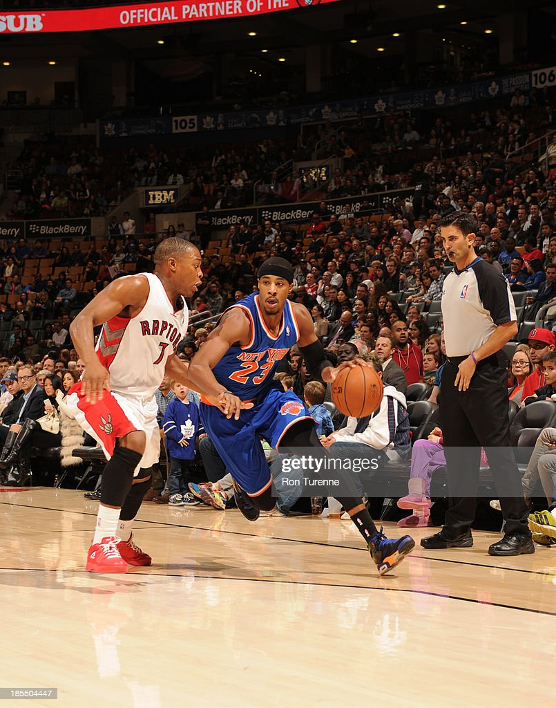 Toure Murry #23 of the New York Knicks drives to the basket against the Toronto Raptors during the game on October 21, 2013 at the Air Canada Centre in Toronto, Ontario, Canada.