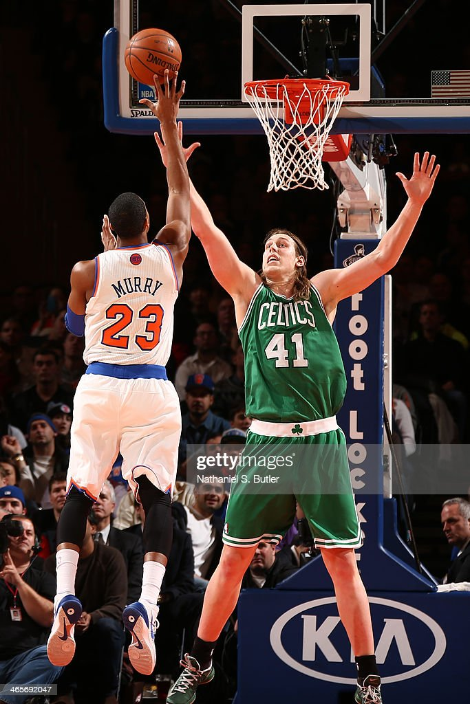Toure' Murry #23 of the New York Knicks shoots against <a gi-track='captionPersonalityLinkClicked' href=/galleries/search?phrase=Kelly+Olynyk&family=editorial&specificpeople=5953512 ng-click='$event.stopPropagation()'>Kelly Olynyk</a> #41 of the Boston Celtics during a game at Madison Square Garden in New York City on January 28, 2014.