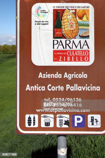 A tourism authority sign welcomes visitors to Antica Corte Pallavicina a farm renowned for its cellaraged Culatello salamis and the restaurants of...