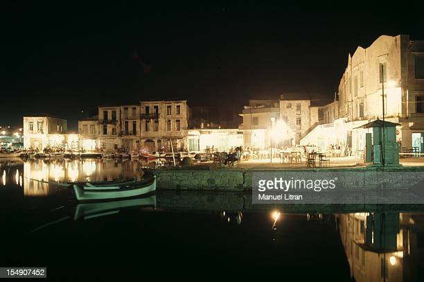 general view of a fishing harbor lights at night