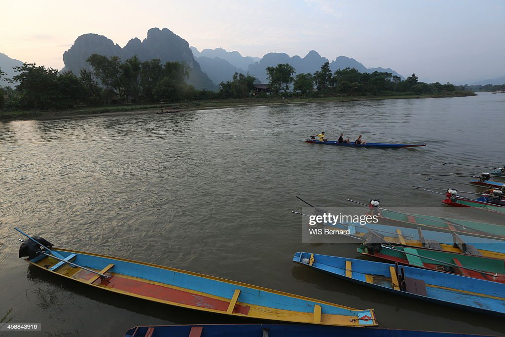 Tourism in Laos in the town of Vang Vieng looking like the Halong bay near the river Nam Song pirogue