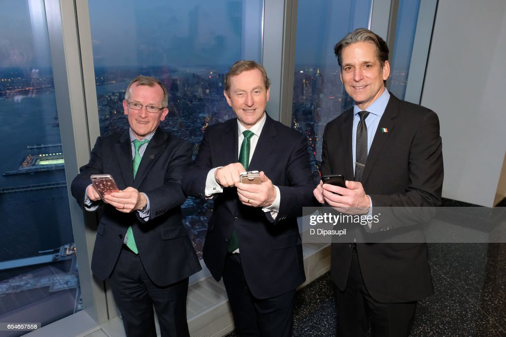 Tourism Ireland CEO Niall Gibbons, Irish Prime Minister Enda Kenny, and Legends General Manager and Vice President John Urban attend as Tourism Ireland marks its St. Patrick's Day Global Greening Initiative at One World Observatory on March 17, 2017 in New York City.