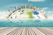 Image of a globe with the worldwide monuments for vacation. Concept of travel to around the world
