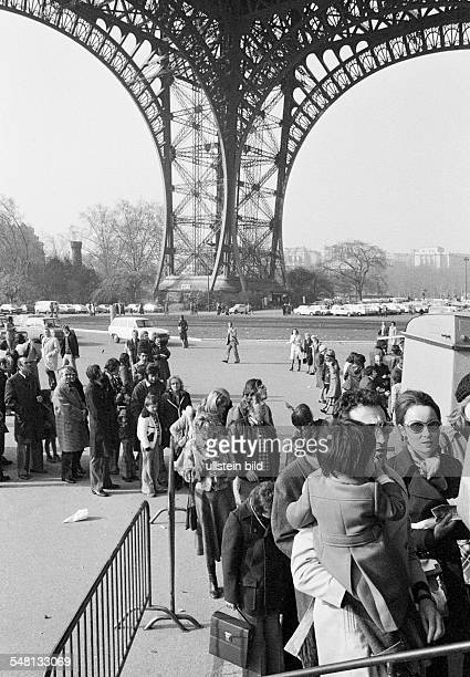 tourism queue of people at the elevator to the observation platform on the Eiffel Tower France Paris