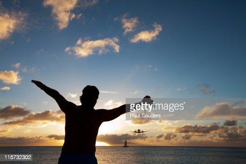 Tourist and Landing Jet, Saint Martin : Stock Photo