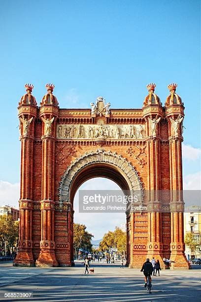 Tourist At Arc De Triomf Against Blue Sky