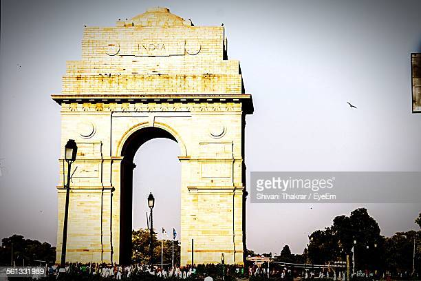 Tourist At India Gate Against Clear Sky