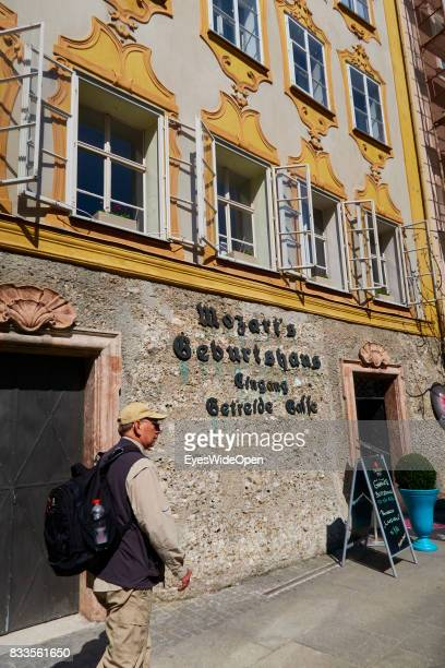 A tourist at the birth place of the famous classical composer and musician Wolfgang Amadeus Mozart on April 19 2015 in Salzburg Austria