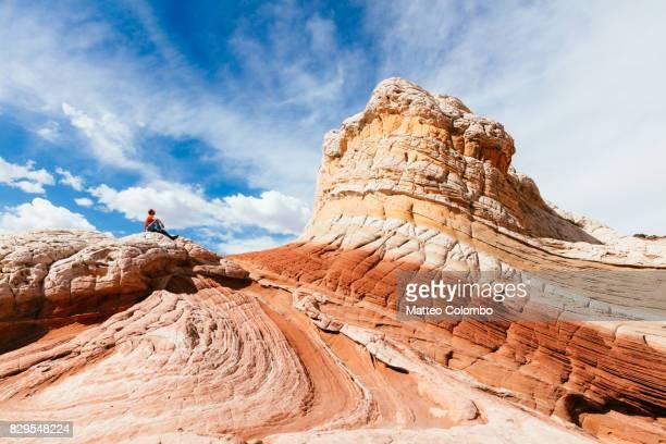 Tourist at White Pocket, Vermillion Cliffs, Arizona, USA