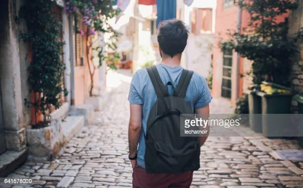 Tourist backpacker traveling in Rovinj